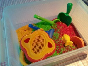 Toys for playing in colored rice
