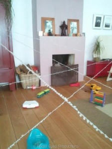 Building a spiderweb in the house. A great gymnastic exercise.
